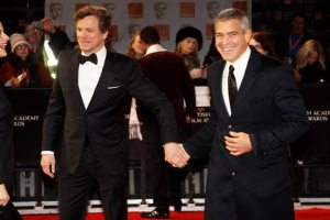 Arriving at the BAFTAs yesterday, George Clooney looks VERY happy holding Colin Firth's hand.....
