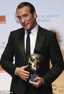 Jean Dujardin holds his Best Actor BAFTA which he received last night.