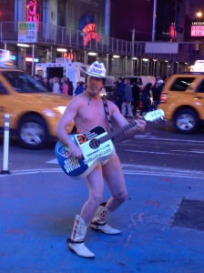The Naked Cowboy doing his thing in Times Square!